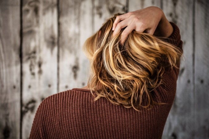 Wash hair less frequently