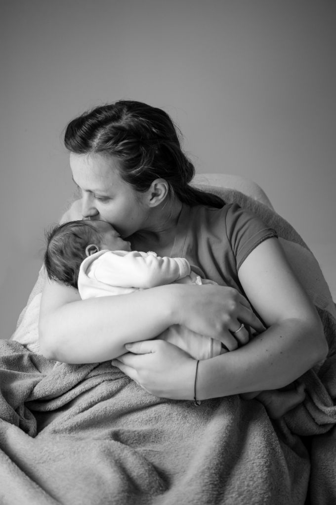 Holding the Baby in one arm